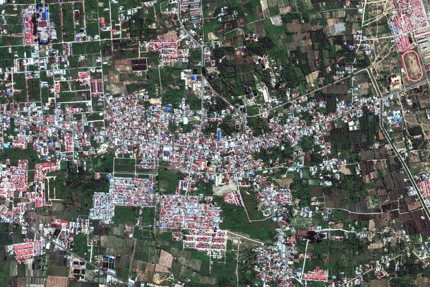 Top: A satellite photo showing Petobo village on Aug 17, before an earthquake struck the region. Above: Petobo as seen on Oct 1 after 700 houses were destroyed.