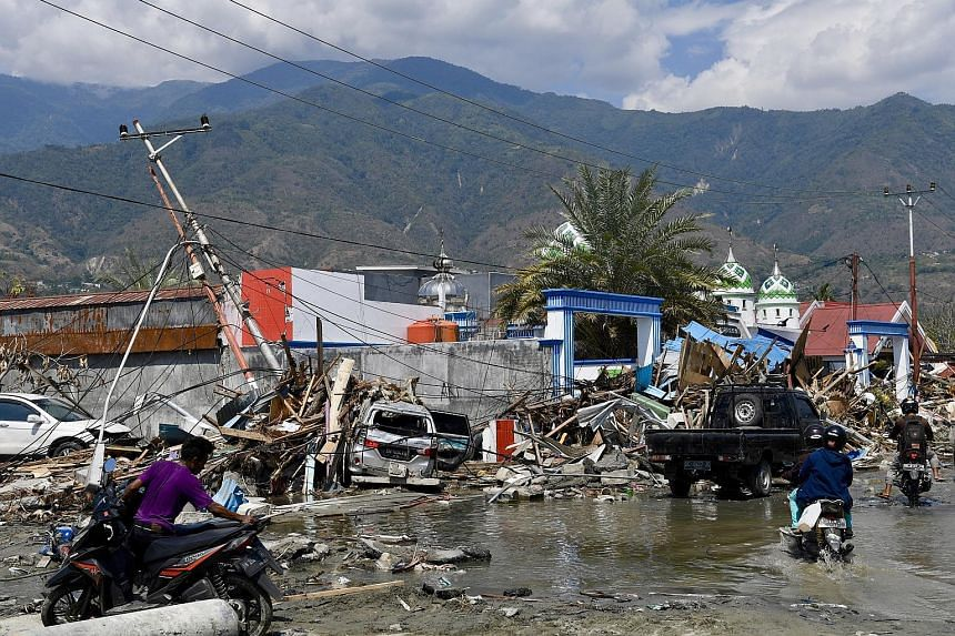 Damaged roads and buildings in the provincial capital of Palu in Central Sulawesi. At least 70,820 people have been displaced after their homes were destroyed in the wake of last Friday's deadly earthquake and tsunami.