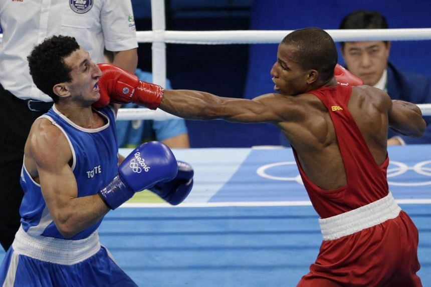 Robson Conceicao (right) of Brazil in action against Sofiane Oumiha of France during the Rio 2016 Olympic Games boxing men's light (60kg) final bout in Rio de Janeiro, Brazil, on Aug 16, 2016.