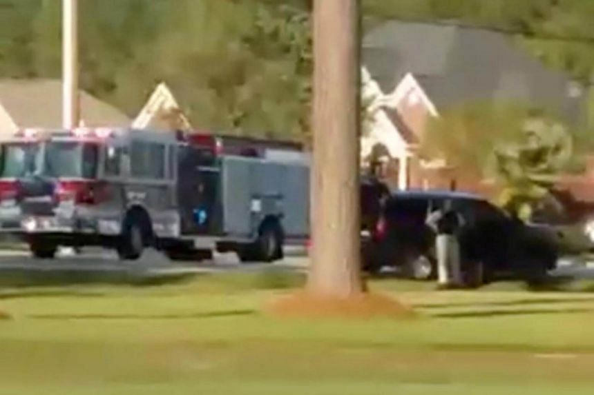 Emergency personnel are seen on site in the aftermath of a shooting in Florence, South Carolina, on Oct 3, 2018.