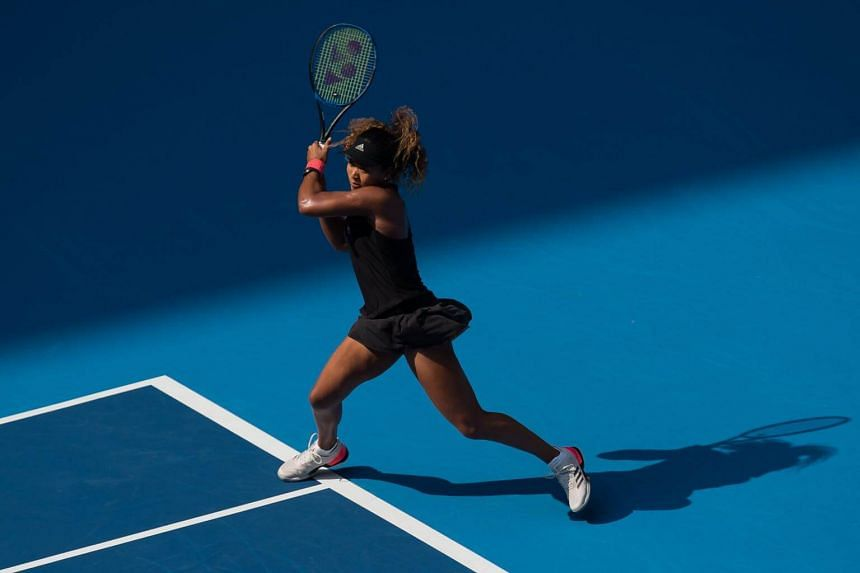Naomi Osaka of Japan hits a return during her women's singles third round match against Julia Goerges of Germany at the China Open tennis tournament in Beijing on Oct 4, 2018.
