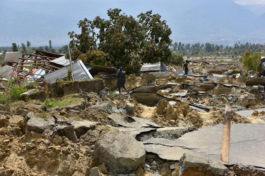 "The village of Petobo, which lies 10km from Palu, Sulawesi, is now known as the ""sunken village"". At least 700 houses were swallowed up and buried during the quake."