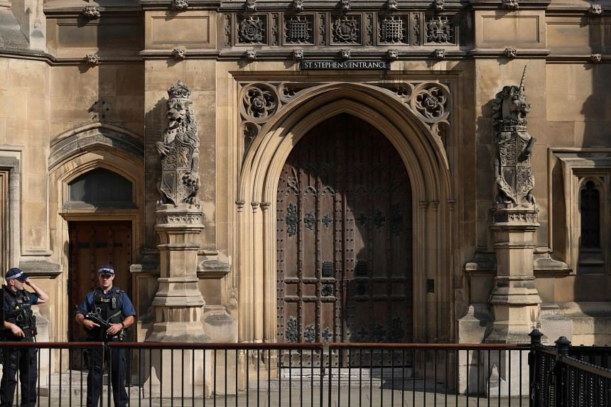 Police officers stand guard at the Houses of Parliament in London in September 2018.