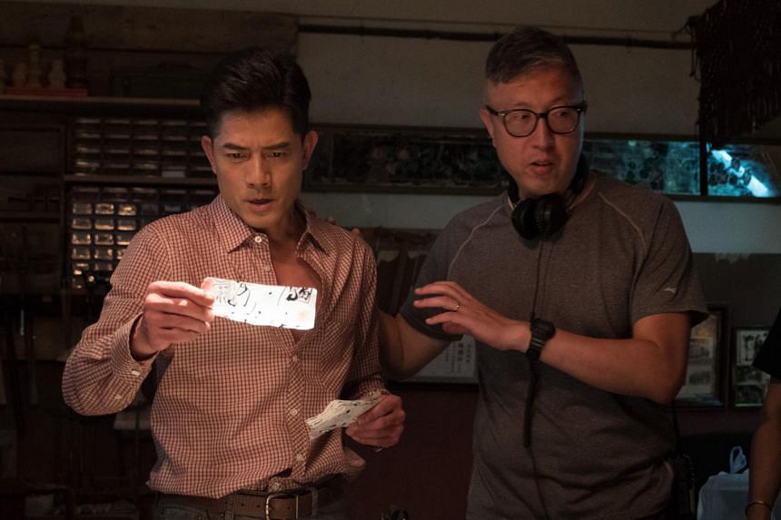 Aaron Kwok (left) with writer-director Felix Chong on the set of Project Gutenberg.