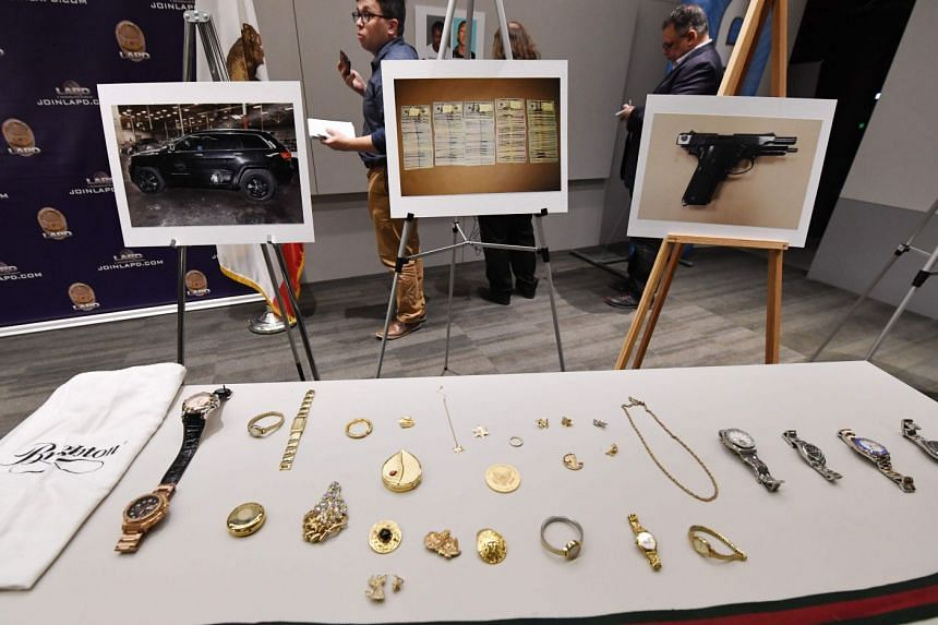 Stolen goods are displayed during a press conference by Los Angeles police to announce the arrest of four suspects in connection to a spate of high-profile burglaries.