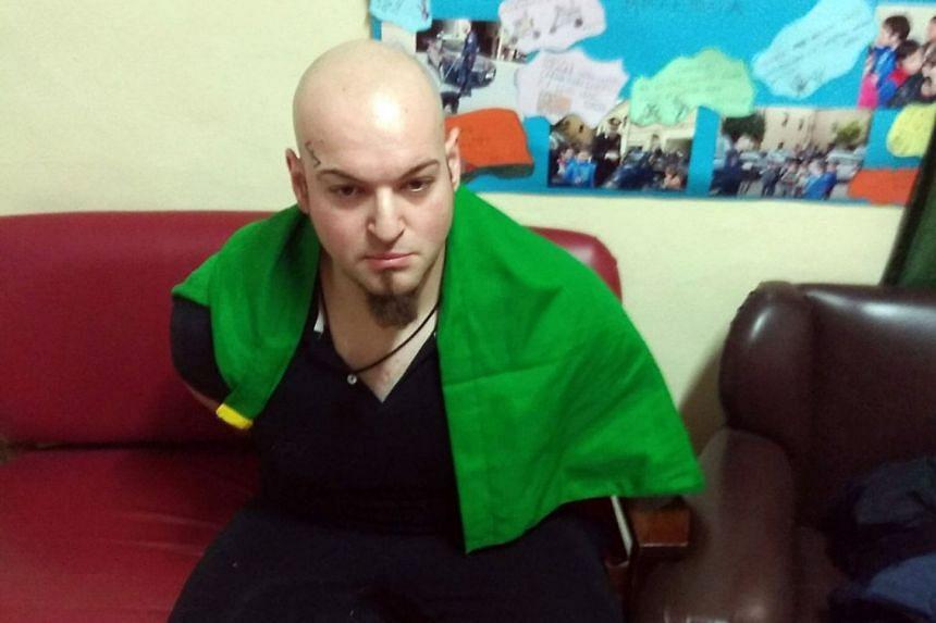 A file photo showing Italian national Luca Traini under arrest.