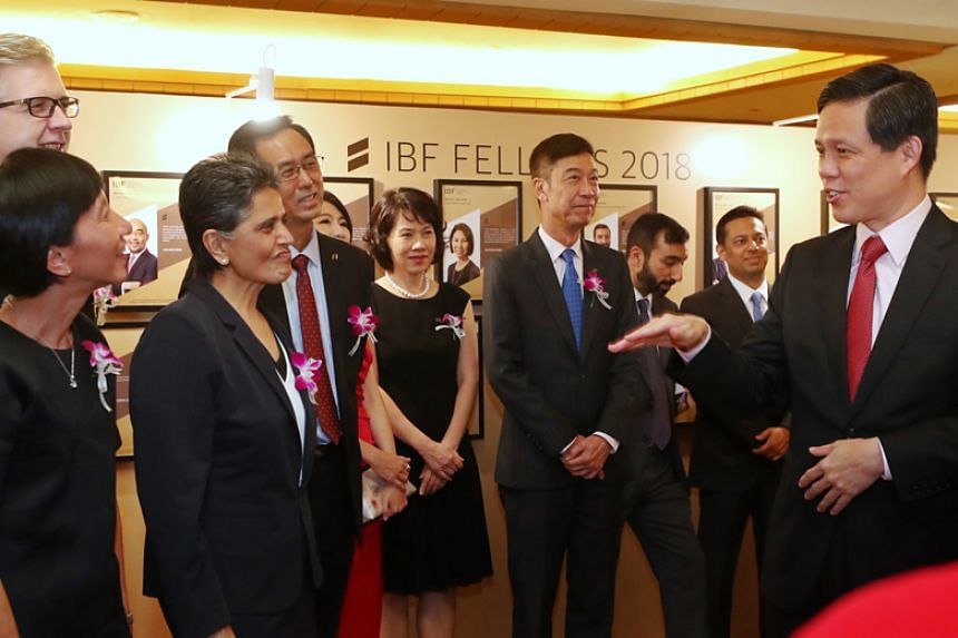 Minister for Trade and Industry Chan Chun Sing with some of the award recipients at the Institute of Banking and Finance's annual gala dinner on Oct 4, 2018.
