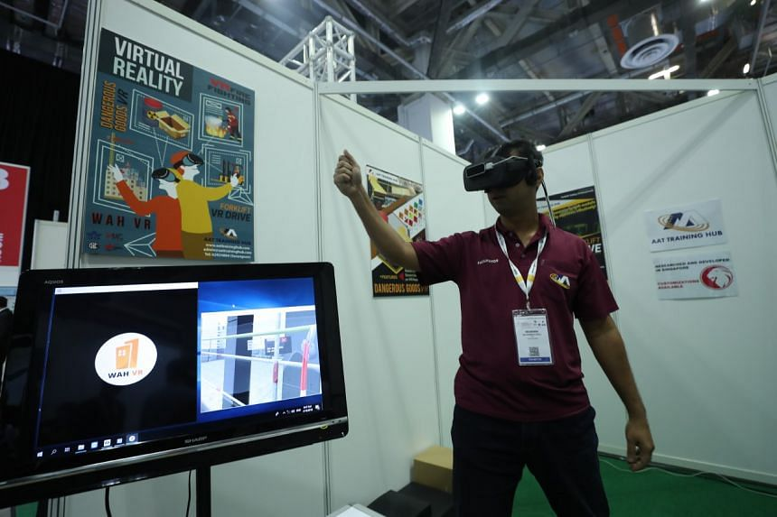 A demonstrator showing how virtual reality can be used in safety training for workers. ST PHOTO: TIMOTHY DAVID