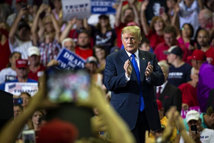 Donald Trump is cheered at a rally in Southaven, Mississippi, on Oct 2, 2018.