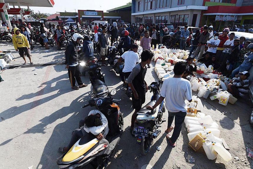 People waiting in line to purchase fuel in Palu, Indonesia, on Oct 3, 2018.