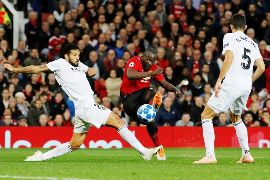 Manchester United's Romelu Lukaku trying to shoot against Valencia's Ezequiel Garay and Gabriel Paulista but to no avail. The Belgium striker was heavily criticised by former United defender Rio Ferdinand following Tuesday's 0-0 Champions League draw