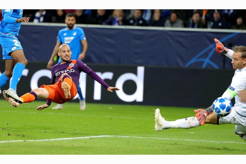 Manchester City's David Silva scoring a late winner past Hoffenheim goalkeeper Oliver Baumann in the 2-1 Champions League win. City are now second in Group F, a point behind Lyon.