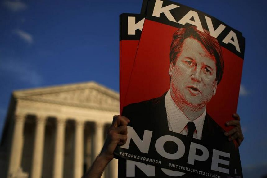 Protesters demonstrating against Supreme Court nominee Brett Kavanaugh outside the US Supreme Court in Washington, on Oct 3, 2018.