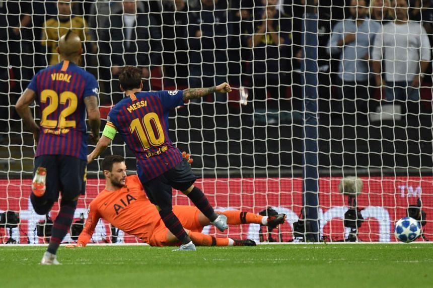 Barcelona's Lionel Messi scoring his team's fourth goal against Tottenham goalkeeper Hugo Lloris.