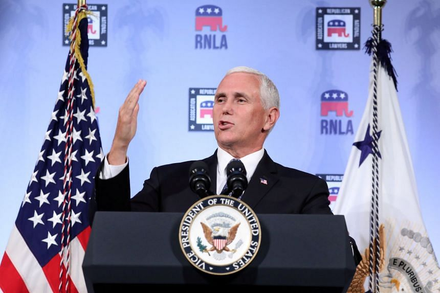 """Pence (above, in a file photo) accused China of """"meddling"""" in America's democracy."""