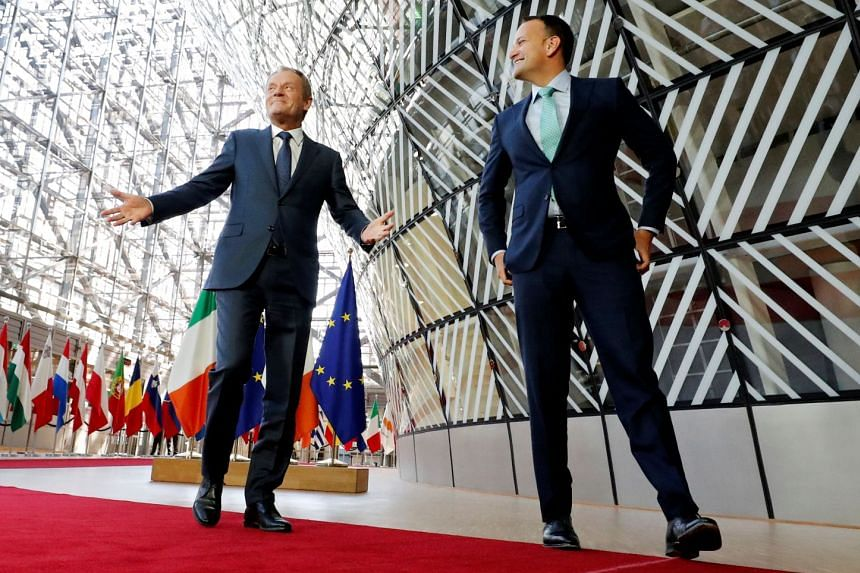 Ireland's Prime Minister Leo Varadkar (right) is welcomed by European Council President Donald Tusk ahead of a meeting to discuss Brexit in Brussels, Belgium.