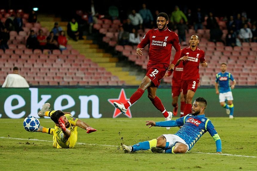 Napoli's Lorenzo Insigne scoring against Liverpool goalkeeper Alisson to give his side a 1-0 Champions League victory on Wednesday. In a match which saw the Reds record no shots on target, the Italian's goal was enough to take his team to the top of