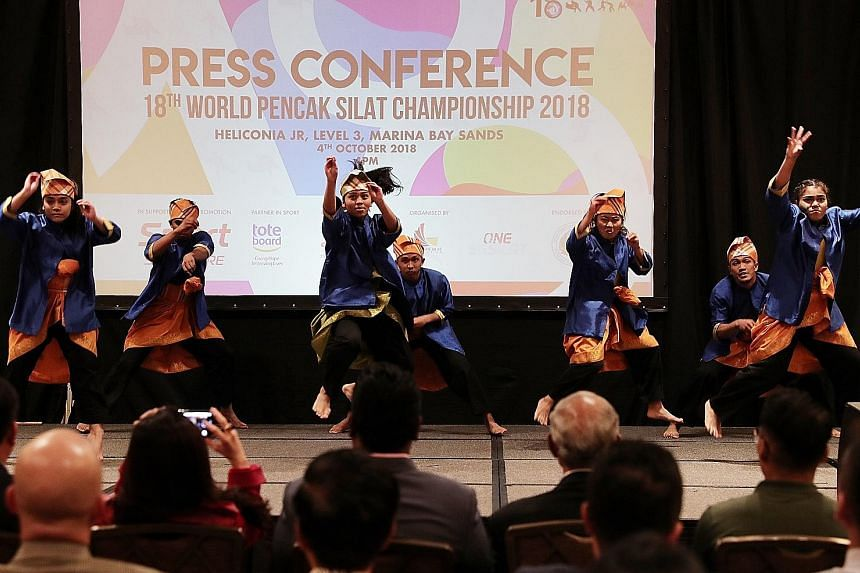 Performers at yesterday's official press conference for the 18th World Pencak Silat Championship in Singapore from Dec 11 to 17. Persisi was given only five months to prepare after Indonesia pulled out as host.