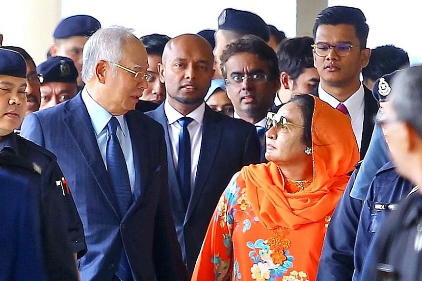 Najib Razak and Rosmah Mansor leaving the Kuala Lumpur Courts Complex together yesterday, where they both appeared in separate courts over their cases.