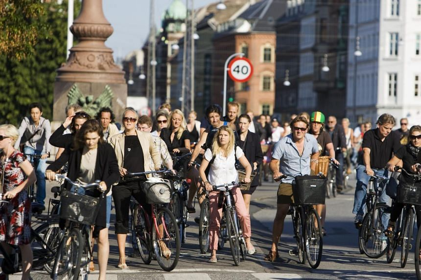 Cyclists at a traffic stop in Copenhagen. Virtually all of the city's 600,000 residents own bicycles, and the city has 375km of dedicated cycle lanes.