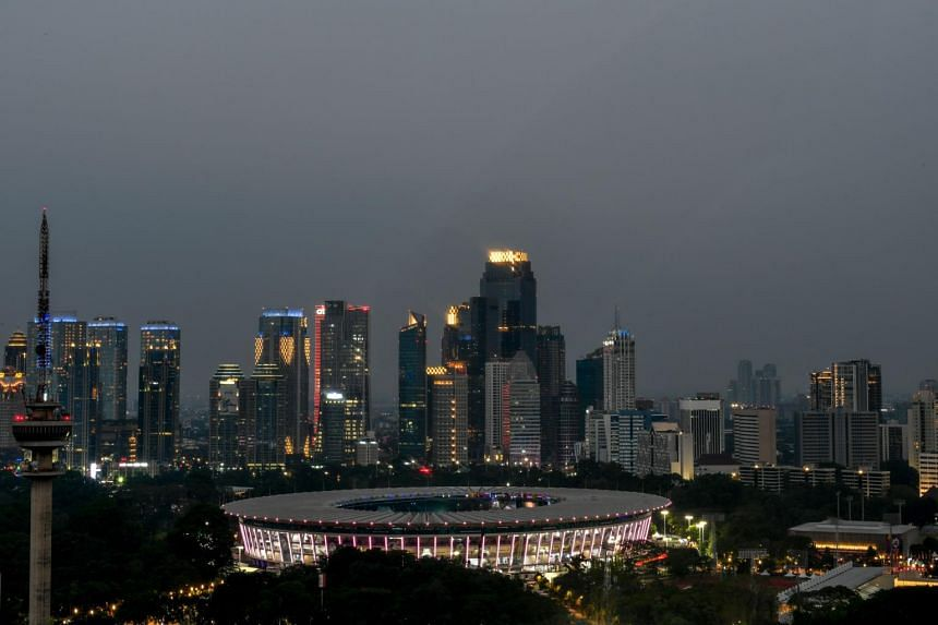 File picture of Jakarta's skyline. The city is sinking 25cm each year and risks being inundated within decades as a mixture of poor planning, megastorms and higher tides wreaks havoc.
