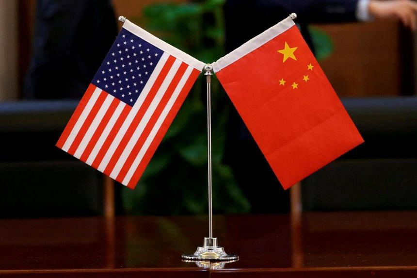 File photo of Chinese and US flags are during a signing ceremony in Beijing, China, on April 27, 2018.
