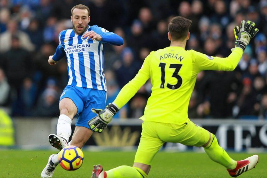 Brighton's Glenn Murray scores their first goal in the match between Brighton & Hove Albion and West Ham United on Feb 3, 2018.