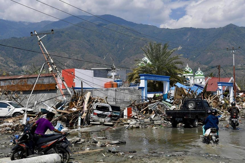 Damaged roads and buildings in quake-hit Palu, Central Sulawesi, on Oct 3, 2018.