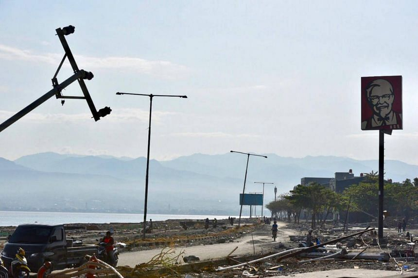Scenes of devastation in Palu city after being struck by an earthquake and a tsunami, on Oct 3, 2018.