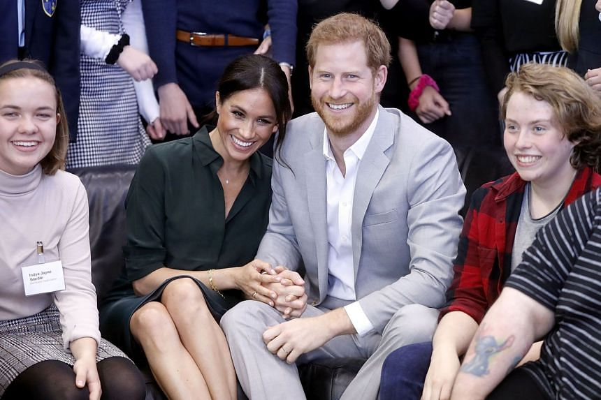 Harry and Meghan visiting a youth centre in Britain on Oct 3, 2018.