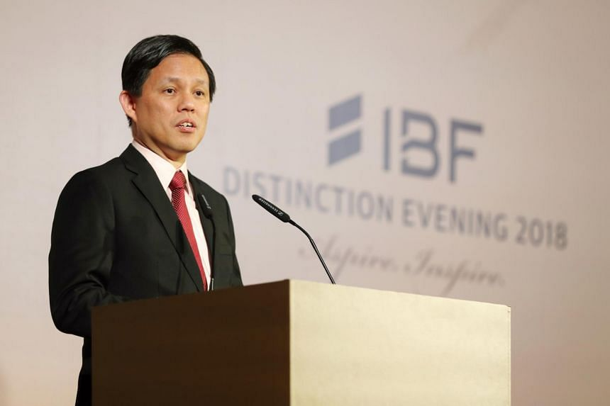 Trade and Industry Minister Chan Chun Sing at an Institute of Banking and Finance event on Oct 4, 2018. He said that the risk of a protracted conflict between China and the US raises worries about the global economy.