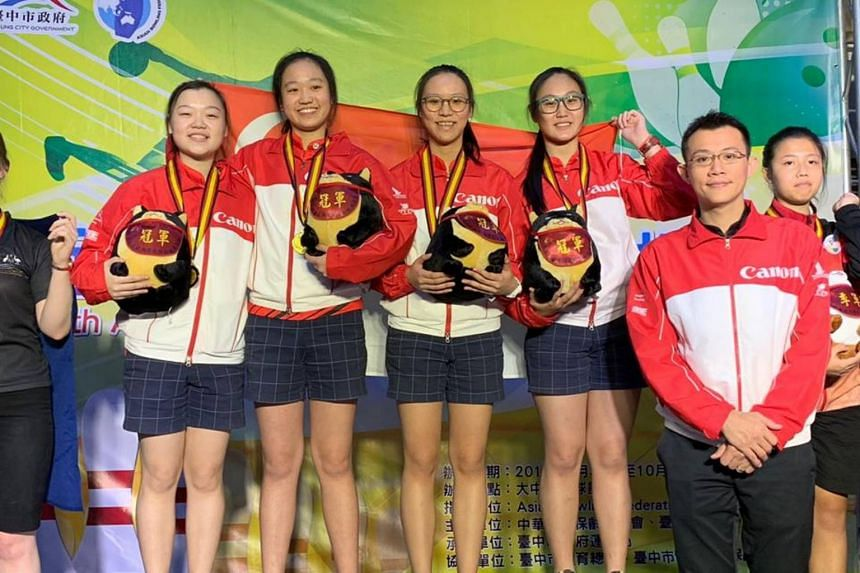 (From left) Singapore bowlers Quek Lu Yi, Arianne Tay, Alena Dang and Colleen Pee with coach Jensen Lim at the prize presentation ceremony for the 19th Asian School Tenpin Bowling Championships in Taichung on Oct 5, 2018.