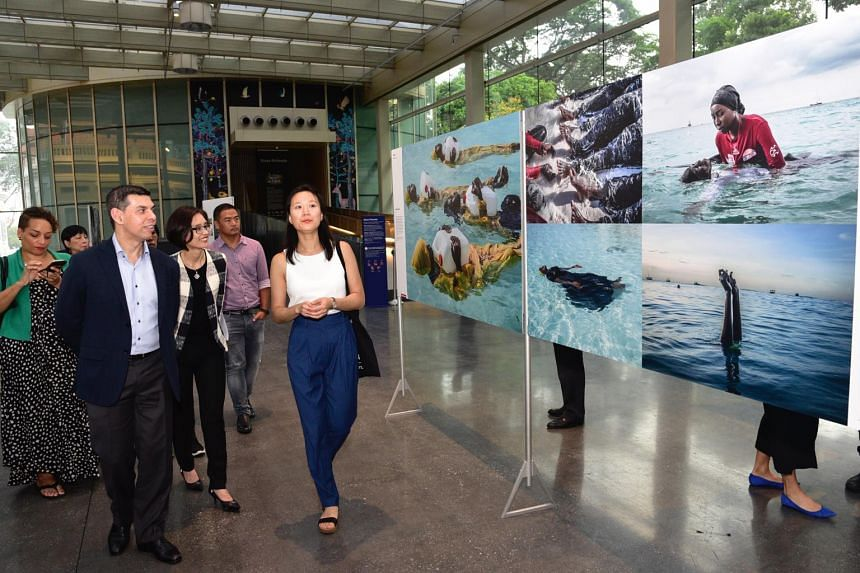 Mr Warren Fernandez and Ms Chang Hwee Nee touring the World Press Photo Exhibition 2018.
