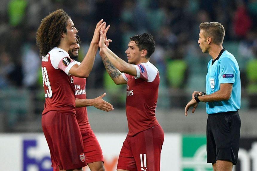 Arsenal's players celebrate after beating Qarabag.
