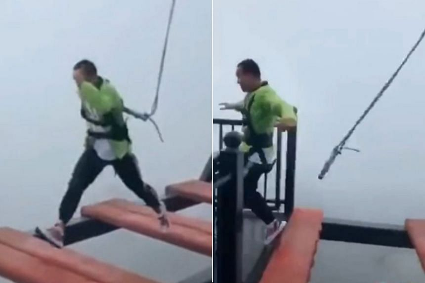 Just as a man was making a final leap across a large gap on a giant suspended walkway at the Wansheng Ordovician Theme Park, a safety harness attached to his waist came loose.
