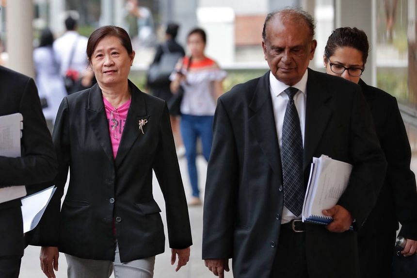 FM Solutions and Services (FMSS) owner How Weng Fan (left) and lawyer Leslie Netto arrive at the Supreme Court on Oct 5, 2018.