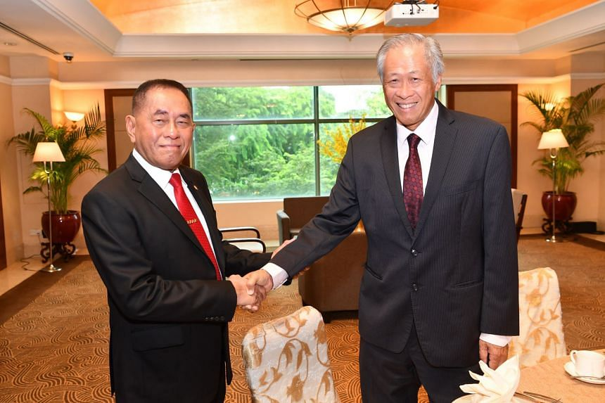 Singapore Defence Minister Ng Eng Hen (right) with Indonesian Defence Minister Ryamizard Ryacudu yesterday. They reaffirmed the close and longstanding bilateral defence ties between the two countries.