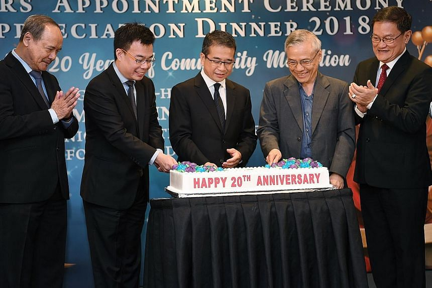 (From left) Community Mediation Unit adviser Lim Lan Yuan, Law Ministry Deputy Secretary Han Kok Juan, Senior Minister of State for Law and Health Edwin Tong, Community Mediation Centre chairman Ho Peng Kee, and executive master mediator Eric Wong at