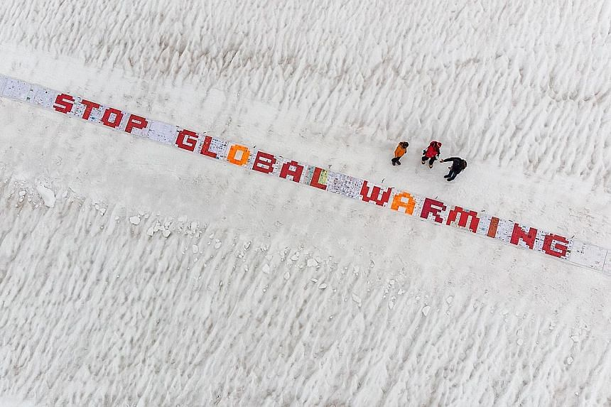 Over 2,500 postcards placed on the Aletsch Glacier in the Swiss Alps on Aug 13, in a test run for a world record attempt to create the largest postcard made up of at least 100,000 standard-sized postcards.