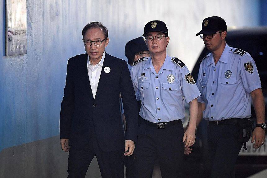 Former South Korean president Lee Myung-bak at his court trial last month. He did not turn up for yesterday's ruling, citing ill health and to protest against the court's decision to televise the ruling.