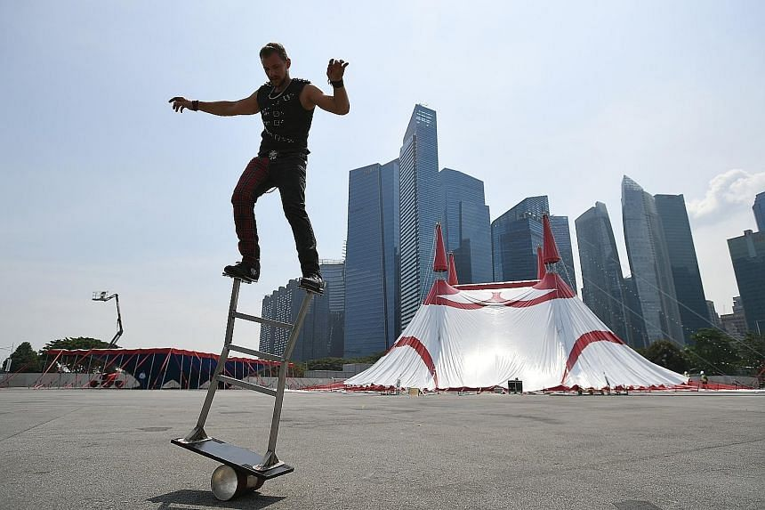 Great Moscow Circus performer Sacha Williams, 29, performing the Rolla Bolla, in front of the troupe's big top set-up beside Marina Bay Sands.