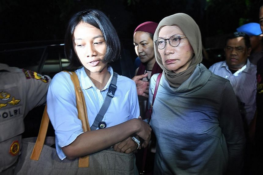 Ms Ratna Sarumpaet (right) lied that an attack by three men last month left her with bruises on her face. She later admitted that they were a result of a cosmetic procedure. She was arrested at Jakarta's airport on Thursday.