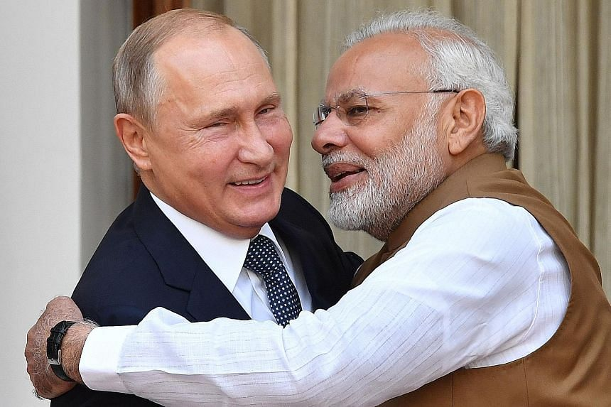 Indian Prime Minister Narendra Modi welcoming Russian President Vladimir Putin in New Delhi yesterday. Under the deal, India will purchase five S-400 Triumf anti-aircraft weapons systems from Russia.
