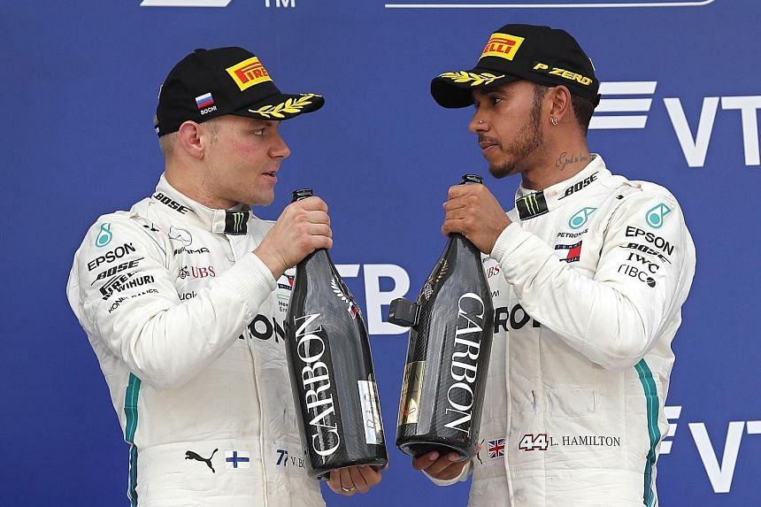 Mercedes' Valtteri Bottas (left) and teammate Lewis Hamilton will do what it takes to help their team win a fifth straight constructors' championship this season.