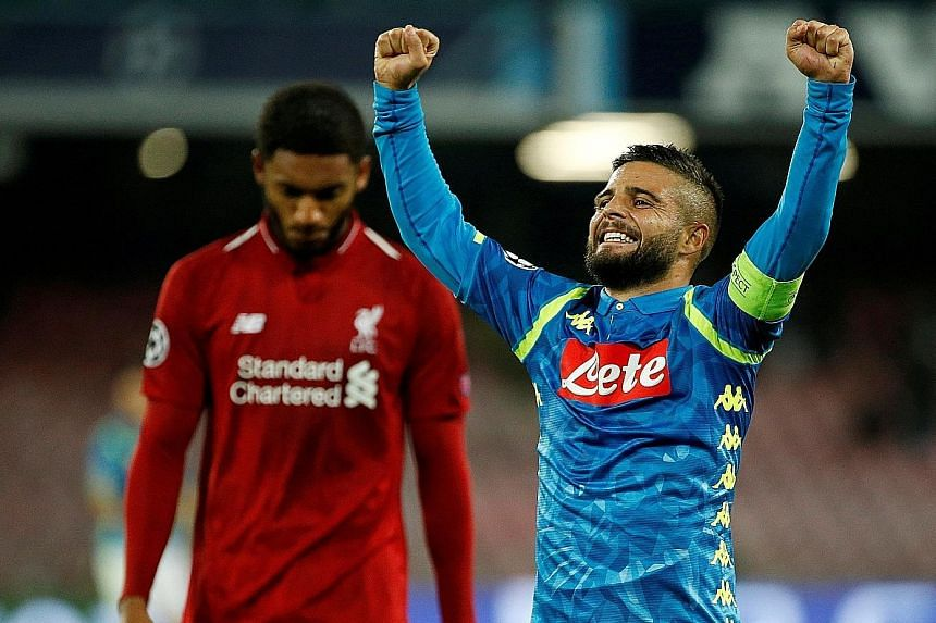Napoli's match-winner Lorenzo Insigne celebrates after the midweek 1-0 Champions League win over Liverpool. The Reds, however, are still unbeaten in the Premier League.