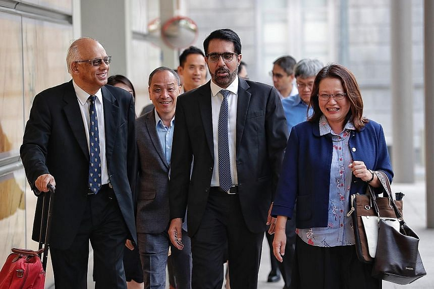 (From left) Senior Counsel Chelva Rajah, Workers' Party former chief Low Thia Khiang, WP secretary-general Pritam Singh and WP chairman Sylvia Lim arriving at the Supreme Court yesterday.