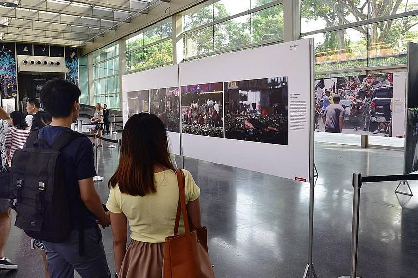Visitors at the launch of the World Press Photo Exhibition 2018 yesterday. It features 161 photos by 42 photographers lauded for their moving images in the non-profit organisation's annual competition.