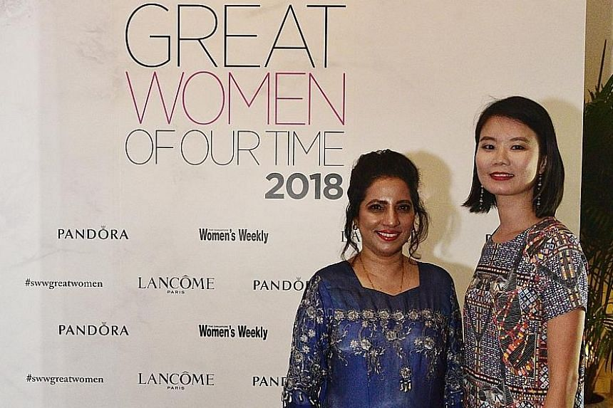 Senior nurse manager Rujia Ali Shahul Hameed Mohammed Feroz (far left) won the award for being the most Inspiring, while A*Star scientist Sherry Aw won in the science and technology category at the Great Women Of Our Time 2018 Awards last night in Si