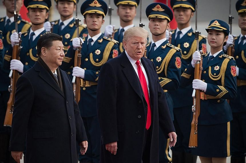 """Chinese President Xi Jinping with US counterpart Donald Trump in Beijing last November. A new US national cyber strategy unveiled by Mr Trump says """"China engaged in cyber-enabled economic espionage and trillions of dollars of intellectual property th"""