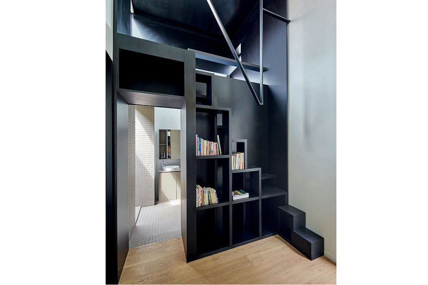 The mezzanine space (above) is where the home owner indulges her passion for painting.